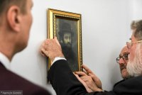 Meir Shapira, Chief Rabbi of Poland Michael Schudrich and Deputy Mayor of Lublin Artur Szymczyk hanging up a portrait of Meir Shapira, donated by Nava Semel, Israeli writer, granddaughter of a sister of the Yeshiva founder.